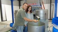 Owners making olive oil