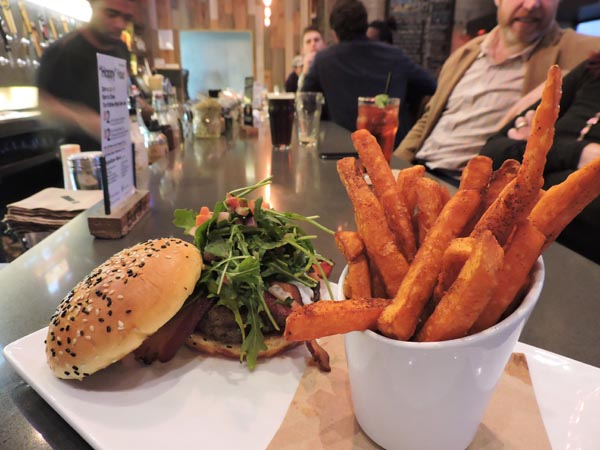 The Fresno Fig Burger is one of their most popular burgers, paired here with sweet potato fries. Photography by Skye Ravy.